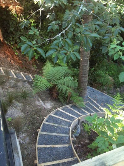 built in steps open the gully up, giving access to the rest of the garden