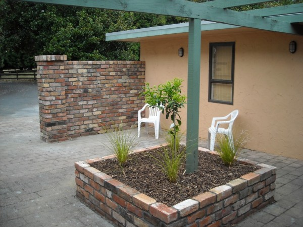 brick wall and raised bed built from recycled brick