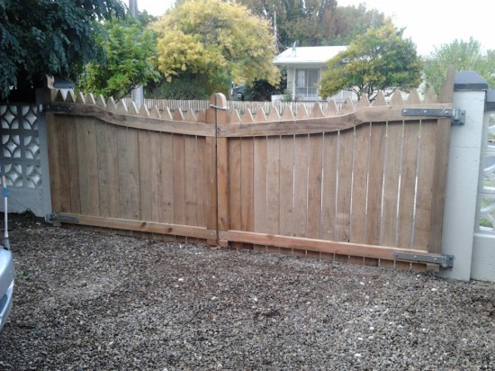 hand crafted double wooden gates keep the dogs in